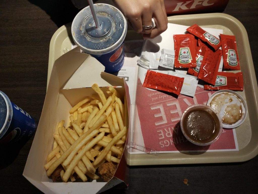 Seriously. One portion of UK's KFC could be consumed with two people. There were lots of chips and four chickens. But expect no seasoning.